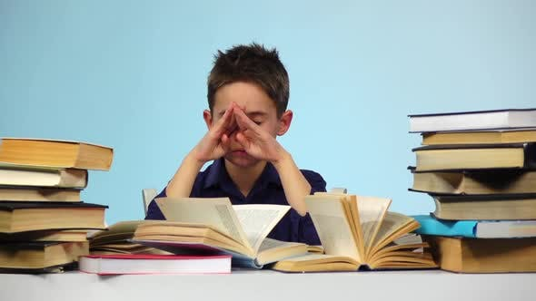 Thumbnail for Boy Wears Glasses and Leafing Through the Book. Blue Background. Slow Motion