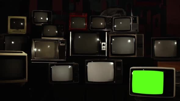 Cover Image for Old TV with Green Screen in a TV Wall.