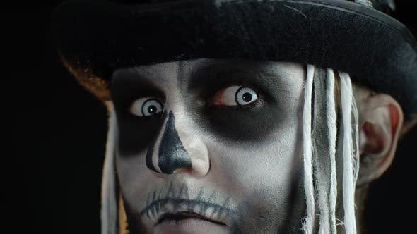 Close-up Shot of Creepy Man in Skeleton Halloween Makeup Opening Eyes and Looking Spooky at Camera