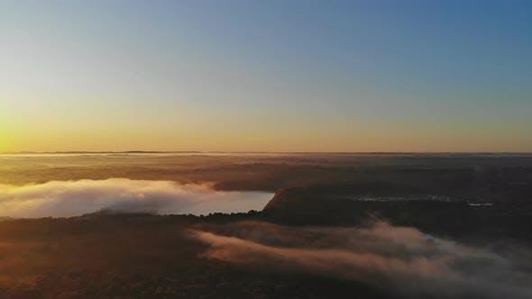 Beautiful Foggy Sunrise Landscape