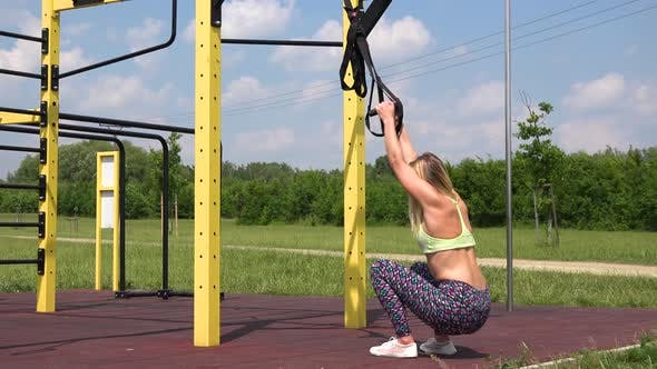 Thumbnail for A Fit Woman Does Assisted Squats at an Outdoor Gym