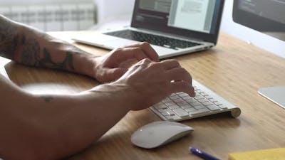 Graphic Designer At Wood Desk
