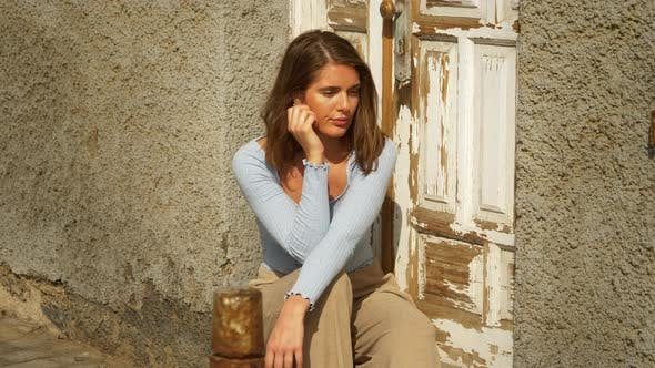 Thumbnail for Pretty Brown-Haired Model with Back Against Door Sitting