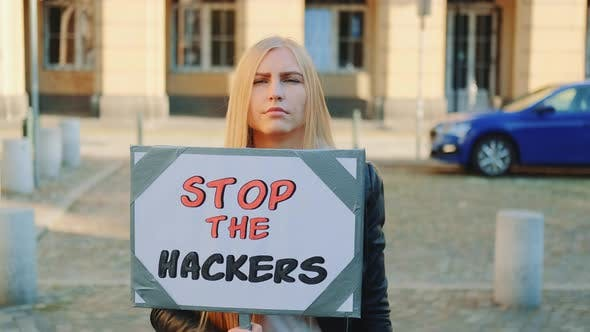 Thumbnail for Concerned Woman with Protest Banner Calling To Stop Hackers