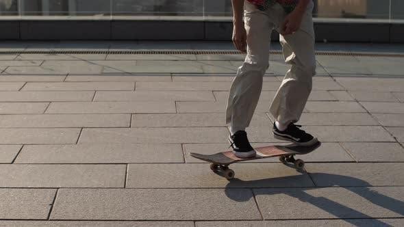 Thumbnail for Feet of Skateboarder Doing Ollie Trick Outside
