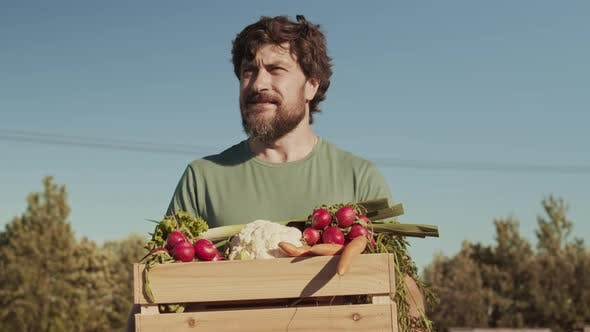Thumbnail for Portrait of Male Farmer Carrying Box of Vegetables