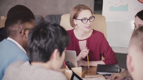 Thumbnail for Successful Beautiful Female CEO Businesswoman Talking To Employees at Multiracial Team Meeting