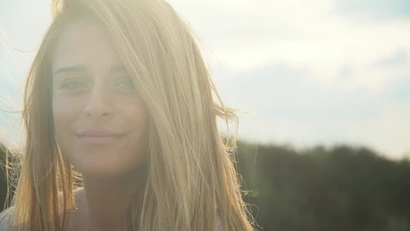 Thumbnail for Portrait Cute Young Beautiful Woman with Amazing Blond Hair in the Wind