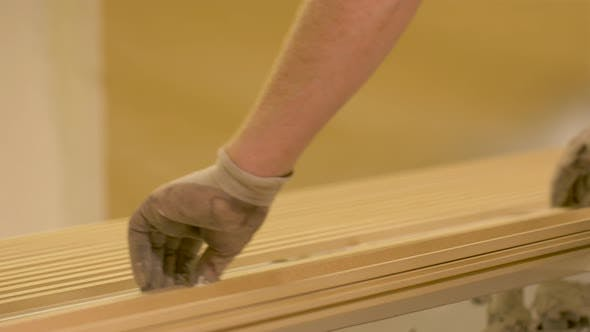 Thumbnail for Worker Hands Placing Wooden Boards at Workshop