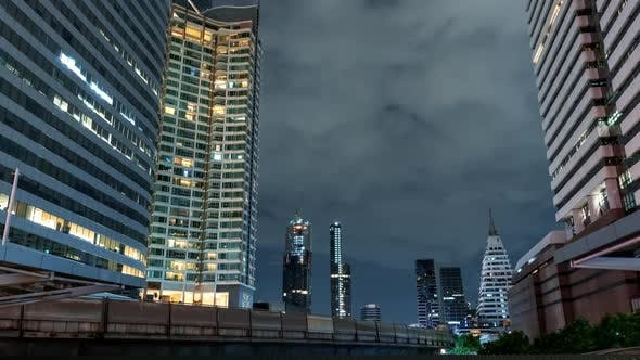 Thumbnail for Time Lapse View of Skyscrapers in Business District at Night Time
