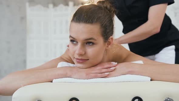 Thumbnail for Handsome Young Woman During Massage on the Back in Spa Salon