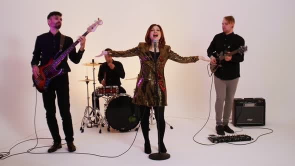 Thumbnail for A Musical Band of Four People Playing Song in the Bright Studio
