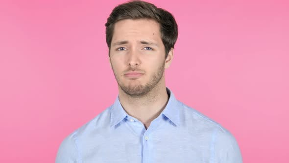 Thumbnail for No, Disliking Young Man on Pink Background