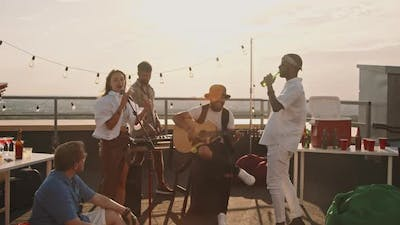 Musicians Playing at Rooftop Party