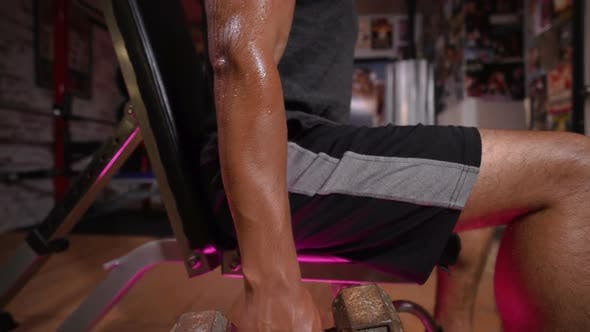 Thumbnail for Young Man Exercising with Dumbbells