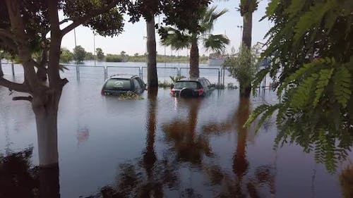 Flooded Cars in the Parking Road. Deep Waters. Flooding Nature After Heavy Rainy Day.
