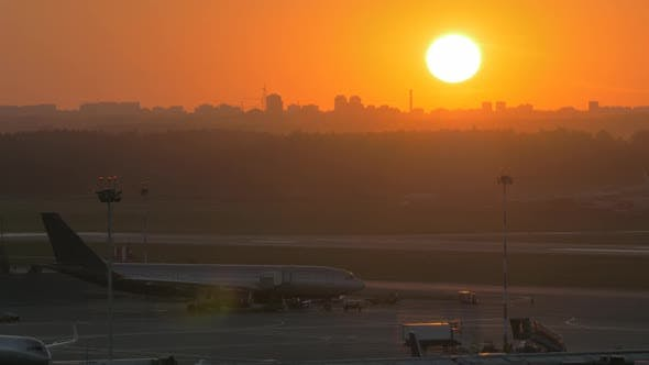Thumbnail for - Golden Sunset and Airport View