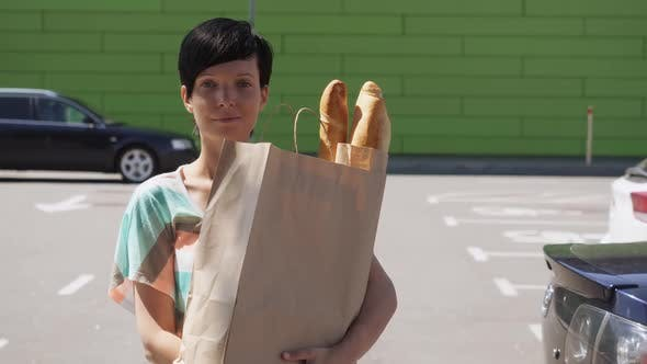 Female Posing with Groceries