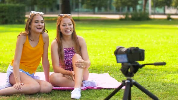 Thumbnail for Teenage Bloggers Recording Video By Camera in Park