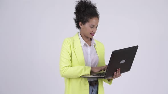 Thumbnail for Happy Young Beautiful African Businesswoman Using Laptop