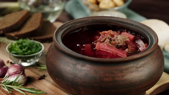 Sprinkling Greenery Dill and Parsley Into Boiled Borsch Closeup Cooking Soup Made of Beetroot