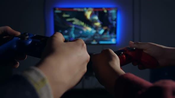 Thumbnail for Closeup Hands Controlling Game Using Joysticks