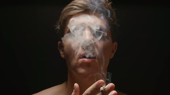 Thumbnail for Smoker under a light