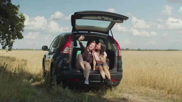 Thumbnail for Joyful Female Friends Taking Selfie in Car Trunk