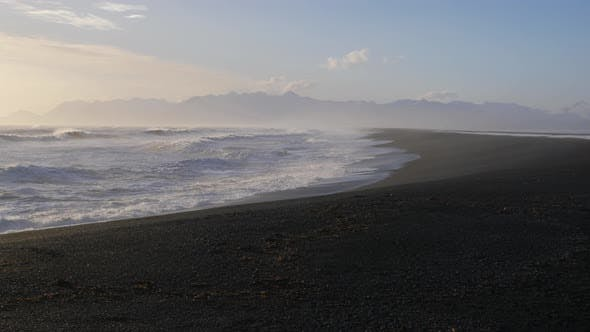 Thumbnail for Iceland Beautiful Black Sand Beach Ocean Shoreline On Sunny Day