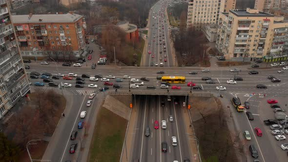 Thumbnail for Aerial Timelapse of the Cars Passing By on a Highway and a Bridge