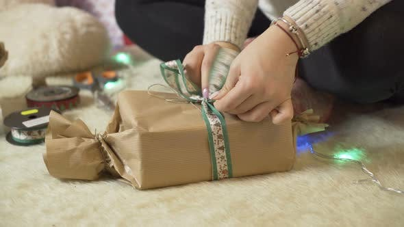 Thumbnail for Pregnant Woman Tying Present Bow for Christmas Gifts