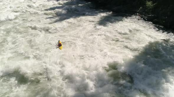 Thumbnail for Breathtaking Aerial Of Extreme Sports Athlete In Kayak Paddling White Water River Rapids
