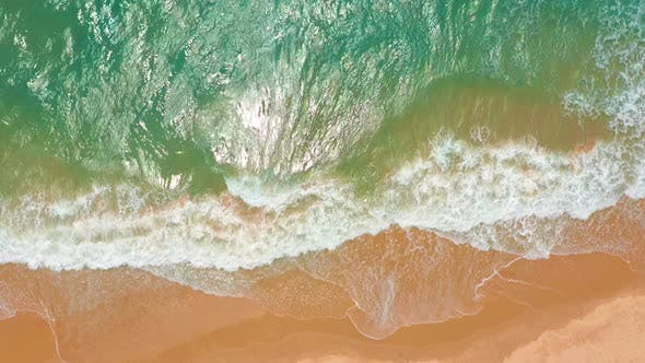 Aerial View. Waves Break on White Sand Beach. Sea Waves on the Beautiful Beach.