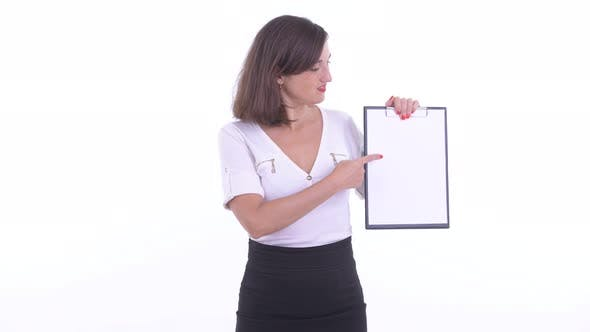 Thumbnail for Stressed Businesswoman Showing Clipboard and Giving Thumbs Down