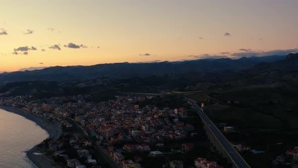Thumbnail for City of Bova Marina at sunset