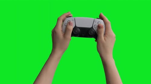 A boy playing games with a friend. The isolated controller on green screen. Stay at home concept.