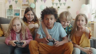 Children Using Video Game Console