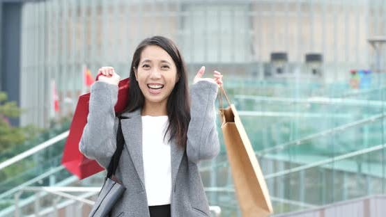 Thumbnail for Woman carrying shopping bag