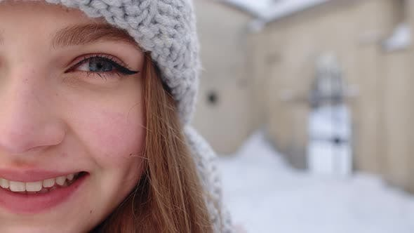 Portrait of Caucasian Pretty Happy Girl with Smile on Face Posing on Winter Citystreet Background
