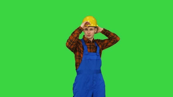 Thumbnail for Single Construction Worker Puts on Safety Hat and Does Some Cool Dancing on a Green Screen, Chroma