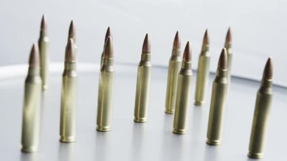 Thumbnail for Cinematic rotating shot of bullets on a metallic surface - BULLETS 059
