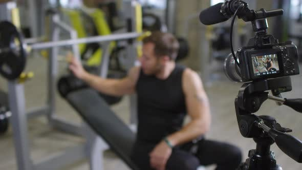 Thumbnail for Gym Coach Explaining Barbell Exercise on Camera