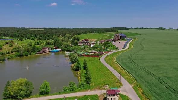 Aerial view of vacation resort. Water pool in courtyard in resort complex