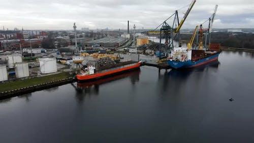 Bulker ships and cranes