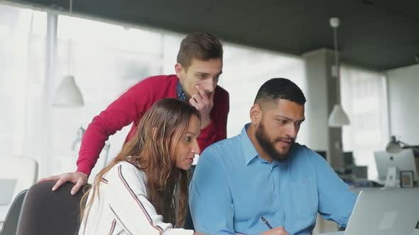 Thumbnail for Thoughtful Business Team Working with Laptop Together