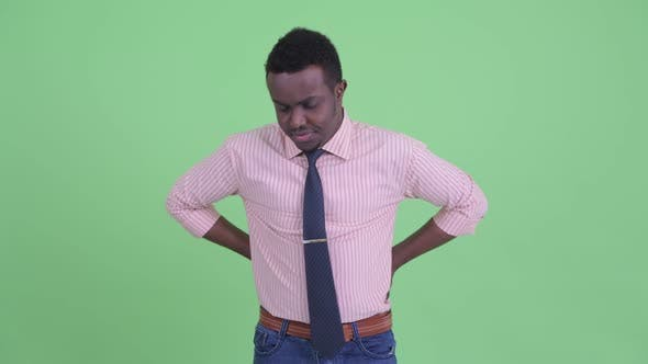 Thumbnail for Stressed Young African Businessman Having Back Pain