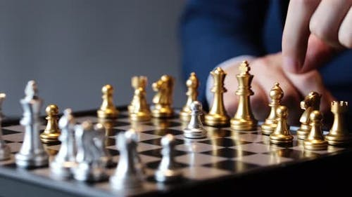 Cropped Shot of Businessman Playing Chess
