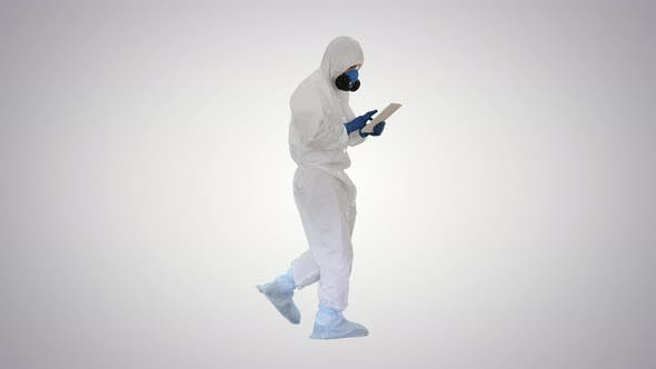 Thumbnail for Scientist or Docrot Wearing Biohazard Suits and Protective Masks Using Digital Tablet While Walking