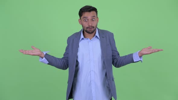 Thumbnail for Confused Young Bearded Persian Businessman Shrugging Shoulders