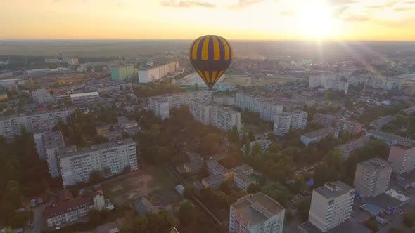 Thumbnail for Blue-And-Yellow Air Balloon Flying Over Town at Dawn Towards Sun, Fantasies